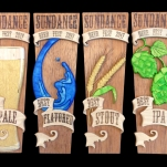Tap handle awards for the Sundance Beer Fest 2017. Combination intarsia and pyrography. Spanish cedar base with birch, maple, aspen, yellowheart, and blue pine.