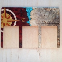 2018. Live edge red Afzelia Burl and Buckeye Burl, with turquoise inlaid between. Compass on the left yellowheart, orangewood, and purnumbuco with a maple ring. Custom playing mat for a card game.