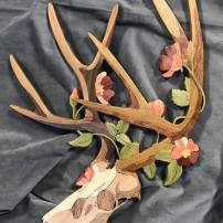 Mule Deer & Prairie Rose, 2019. Holly, Maple, Hickory, Butternut, Cherry, Iroke, Bubinga, Black Walnut, Poplar, Cedar, Yellowheart, Box Elder
